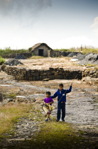 children carrying fishing nets on the coal belt of meghalaya india