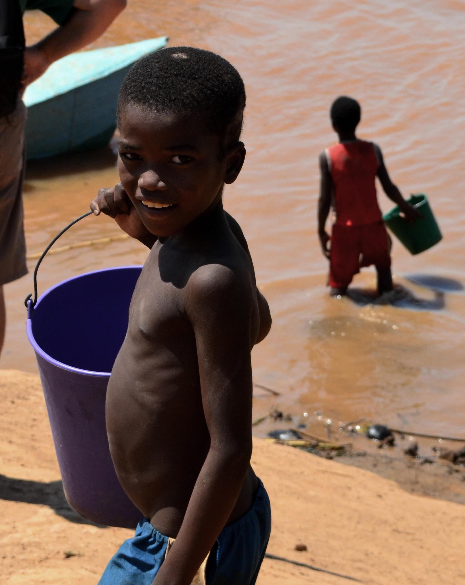 Child in Tsiribihina River in Madagascar