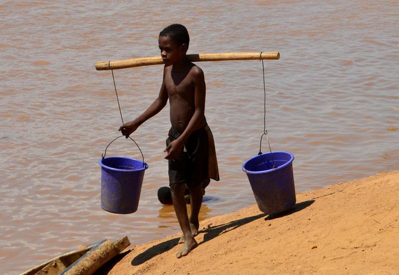 Fetching water in the Tsiribihina River in Madagascar